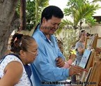 Hawaii Plein Air artist Mark N. Brown shows is students the finer points of Plein Air Art during his art workshop