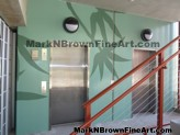 Hosoi Floral Mural makes a plain building come to life. Created by Hawaii mural artist Mark Brown.