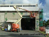 Hawaii Artist Mark N Brown and team work on the Nishimoto Trading Co. Mural