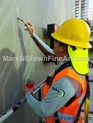 Hawaii artist Mark N Brown is hard at work on the new South Shore Market mural in Kakaako